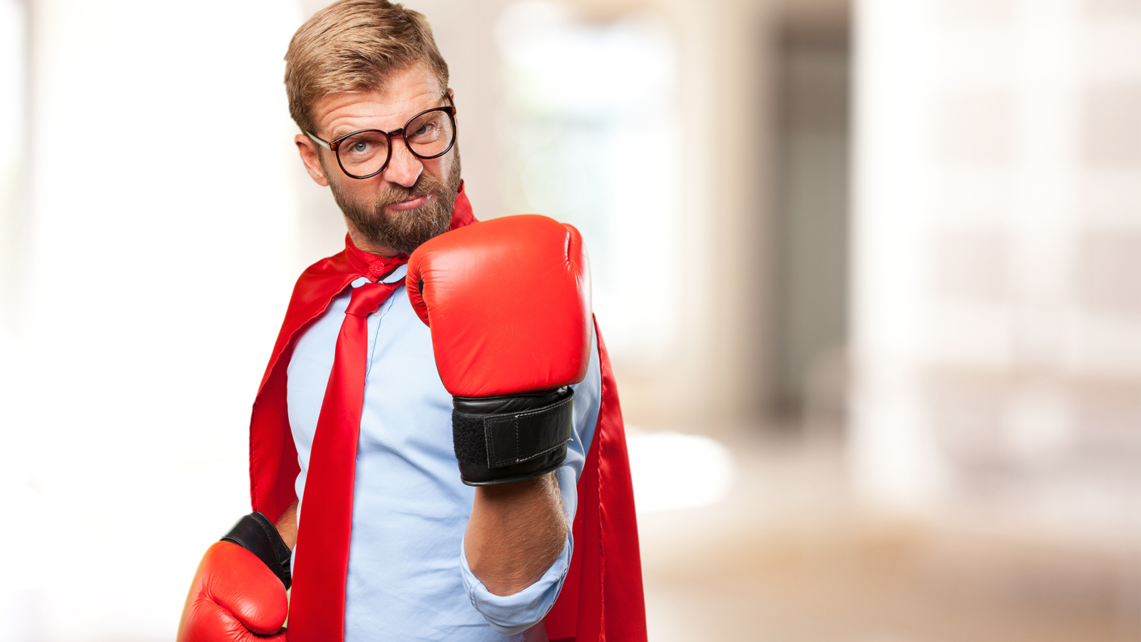 determined-business-man-w-boxing-gloves-and-cape